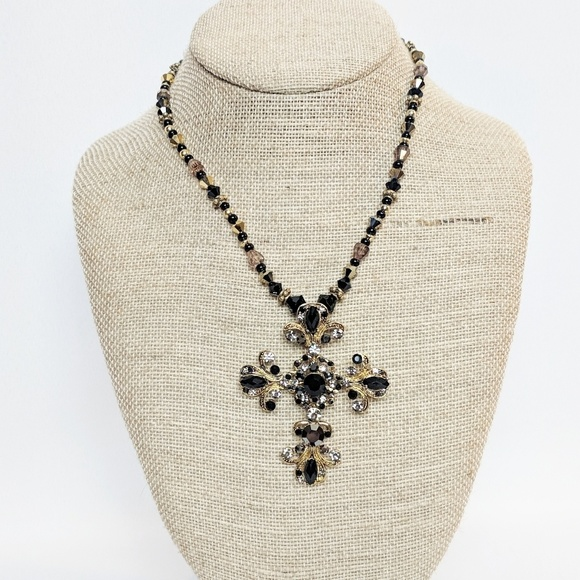 Jewelry - 💥3 for $25💥 Black & Gold Cross Necklace